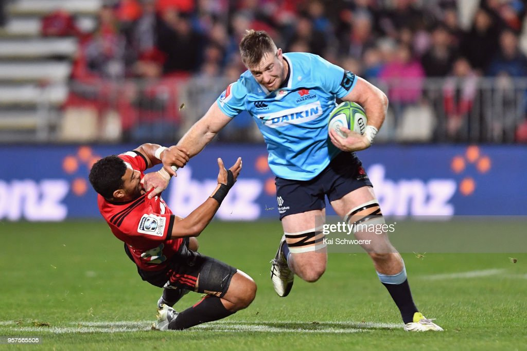 Jed Holloway of the Waratahs is tackled by Richie Mo'unga of the Crusaders during the round 12 Super Rugby match between the Crusaders and the Waratahs at AMI Stadium on May 12, 2018 in Christchurch, New Zealand.