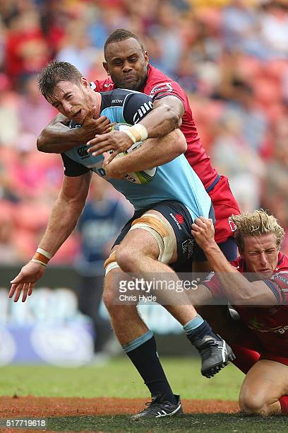 Jed Holloway of the Waratahs is tackled during the round five Super Rugby match between the Reds and the Waratahs at Suncorp Stadium on March 27,...