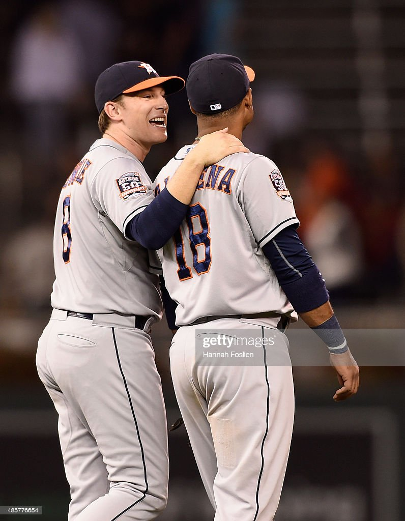 Jed Lowrie #8 and Luis Valbuena #18 of the Houston Astros celebrate a win of the game against the Minnesota Twins on August 29, 2015 at Target Field in Minneapolis, Minnesota. The Astros defeated the Twins 4-1.