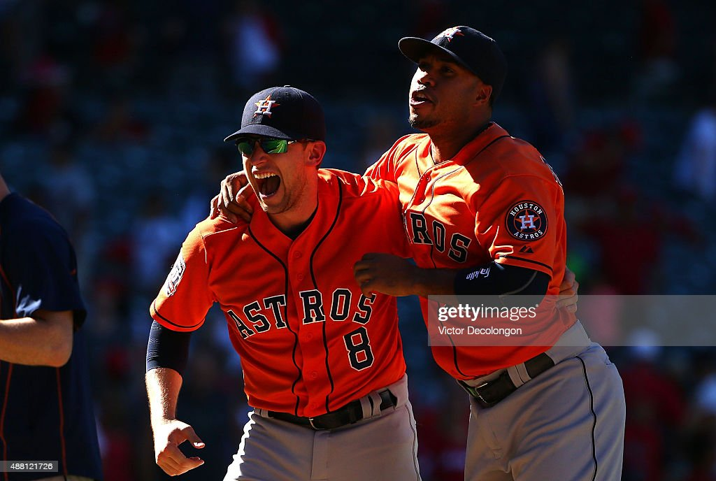 Jed Lowrie #8 and Luis Valbuena #18 of the Houston Astros celebrate after their 5-3 come-from-behind win against the Los Angeles Angels of Anaheim in the ninth inning in their MLB game at Angel Stadium of Anaheim on September 13, 2015 in Anaheim, California.