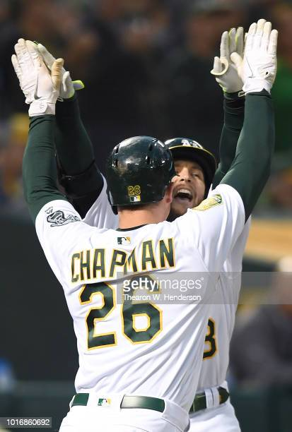 Jed Lowrie and Matt Chapman of the Oakland Athletics celebrates after Lowrie hit a tworun home run against the Seattle Mariners in the bottom of the...