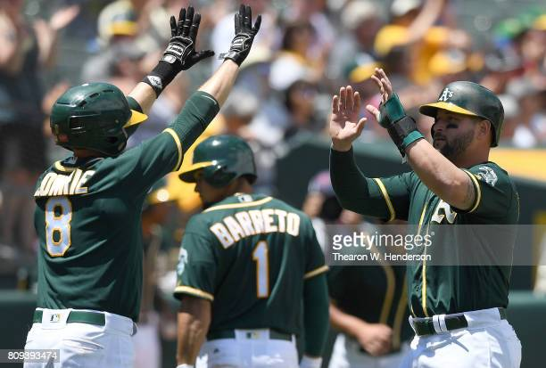 Jed Lowrie and Yonder Alonso of the Oakland Athletics celebrates after they both scored against the Chicago White Sox in the bottom of the third...