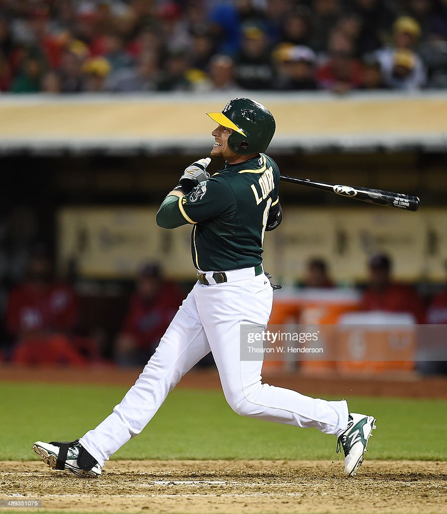 Jed Lowrie #8 fo the Oakland Athletics hits an RBI double scoring John Jaso #5 in the bottom of the ninth inning against the Washington Nationals at O.co Coliseum on May 10, 2014 in Oakland, California.