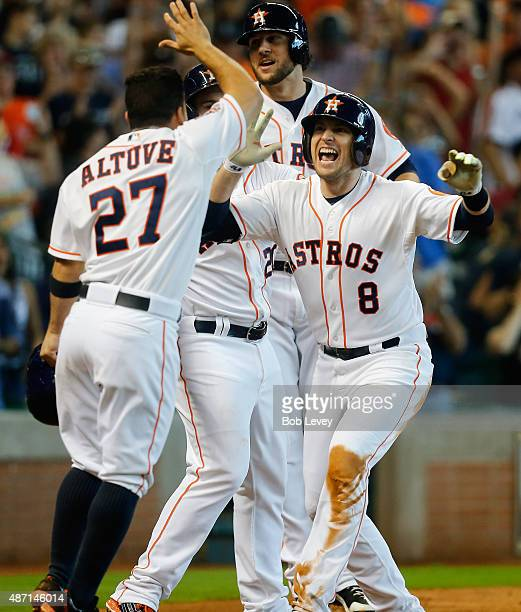 Jed Lowrie of the Houston Astros is congratulated by Jose Altuve Jake Marisnick and Preston Tucker after hitting a grand slam in the seventh inning...