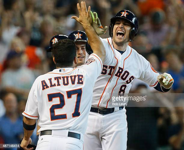 Jed Lowrie of the Houston Astros is congratulated by Jose Altuve Jake Marisnick and Preston Tucker after hittinga grand slam in the seventh inning...