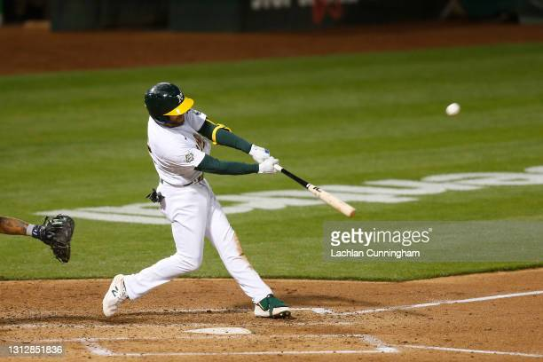 Jed Lowrie of the Oakland Athletics at bat against the Detroit Tigers at RingCentral Coliseum on April 15, 2021 in Oakland, California. All players...