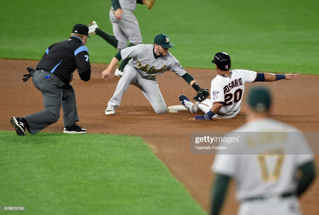 Jed Lowrie #8 of the Oakland Athletics catches Eddie Rosario #20 of the Minnesota Twins stealing second base during the seventh inning of the game on May 2, 2017 at Target Field in Minneapolis, Minnesota. The Twins defeated the Athletics 9-1.