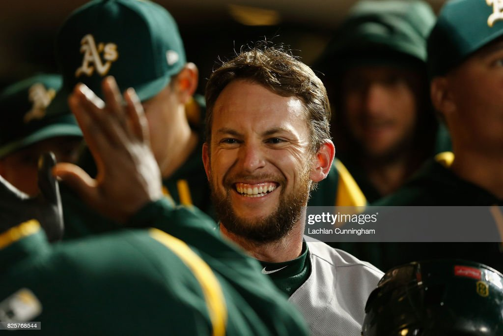 Jed Lowrie #8 of the Oakland Athletics celebrates after scoring a run on a single hit by Chad Pinder #18 of the Oakland Athletics in the seventh inning of an interleague game at AT&T Park on August 2, 2017 in San Francisco, California.