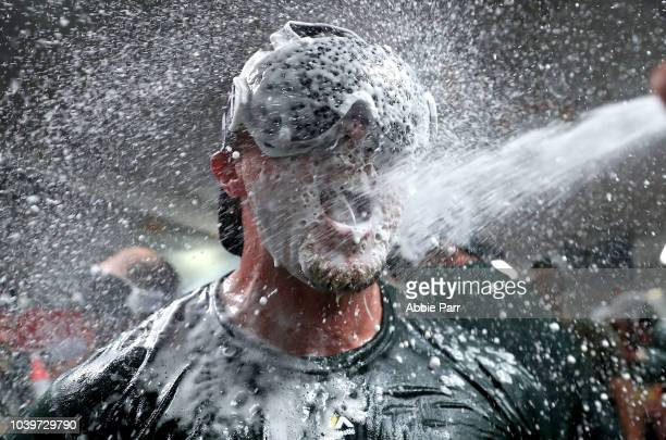 Jed Lowrie of the Oakland Athletics celebrates clinching a spot in the playoffs after beating the Seattle Mariners at Safeco Field on September 24...