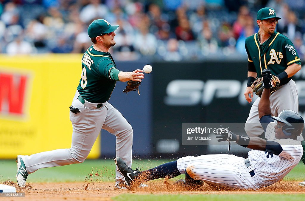 Jed Lowrie #8 of the Oakland Athletics completes a second inning ending double play after forcing out Alfonso Soriano #12 of the New York Yankees at Yankee Stadium on June 5, 2014 in the Bronx borough of New York City.