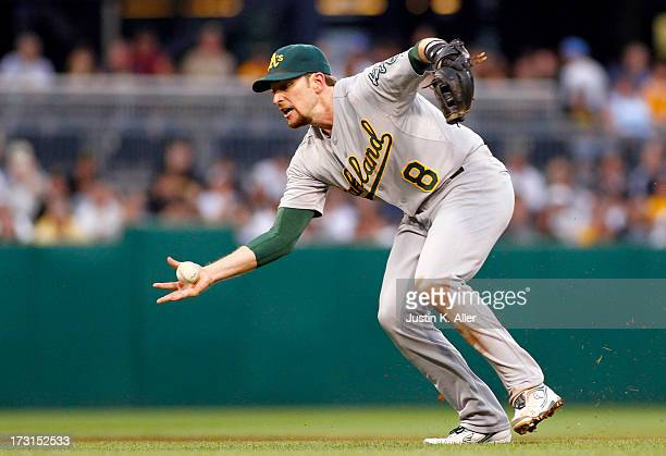 Jed Lowrie of the Oakland Athletics errors in the third inning against the Pittsburgh Pirates during the game on July 8 2013 at PNC Park in...