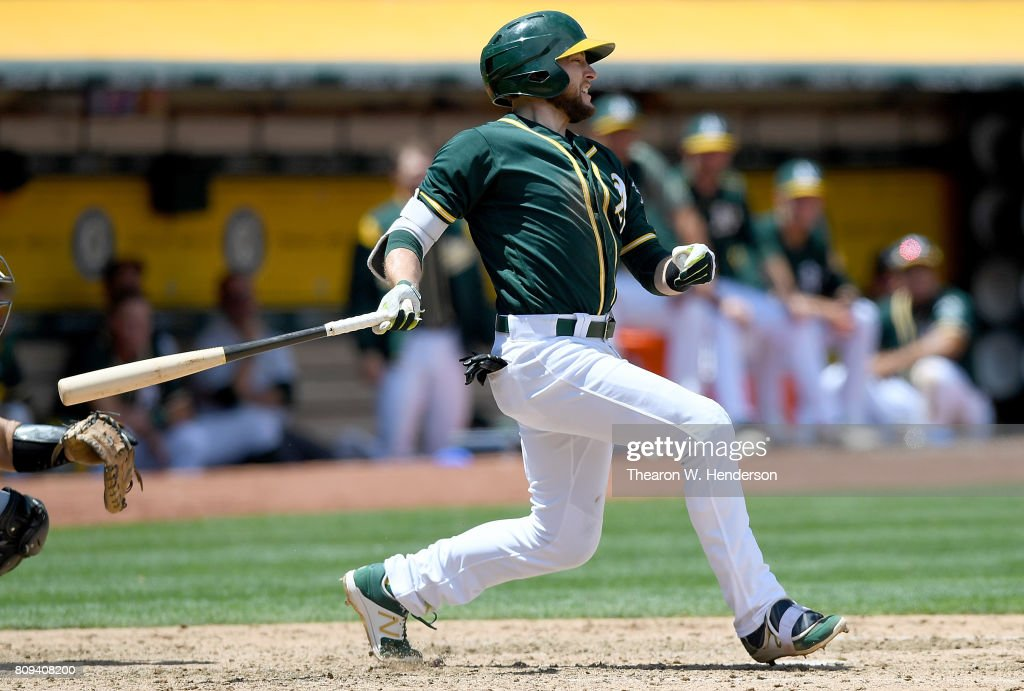 Jed Lowrie #8 of the Oakland Athletics hits a two-run rbi single against the Chicago White Sox in the bottom of the fourth inning at Oakland Alameda Coliseum on July 5, 2017 in Oakland, California.