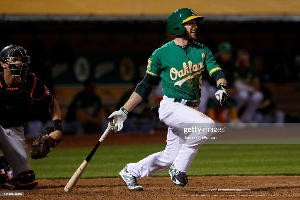 Jed Lowrie #8 of the Oakland Athletics hits an RBI single against the Baltimore Orioles during the sixth inning at the Oakland Coliseum on May 4, 2018 in Oakland, California. The Oakland Athletics defeated the Baltimore Orioles 6-4.