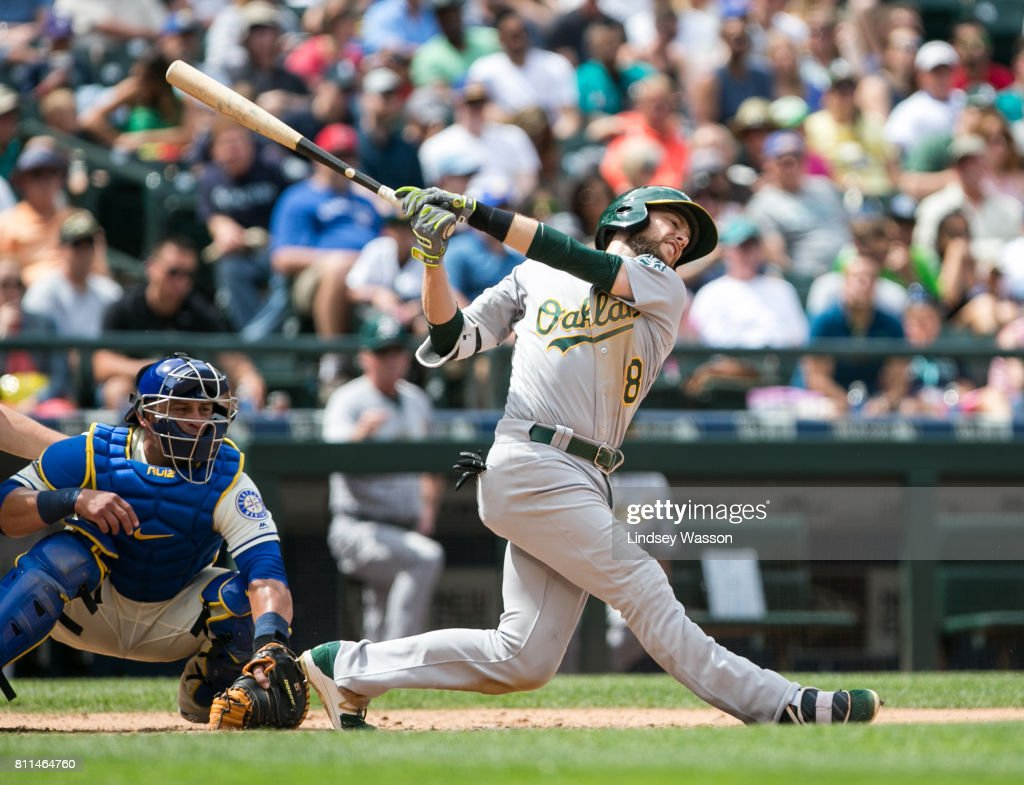 Jed Lowrie #8 of the Oakland Athletics swings hard at a pitch during his strikeout in the sixth inning against Felix Hernandez #34 of the Seattle Mariners at Safeco Field on July 9, 2017 in Seattle, Washington.