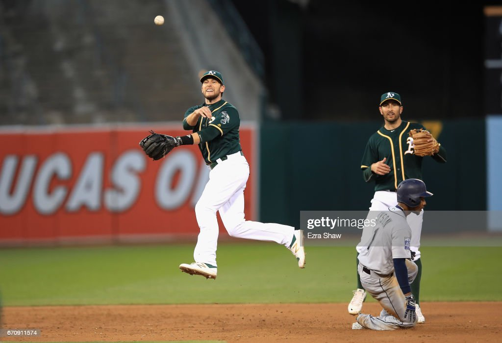 Jed Lowrie #8 of the Oakland Athletics turns an unassisted double play as Jarrod Dyson #1 of the Seattle Mariners slides in to second base on a ball hit by Mitch Haniger #17 of the Seattle Mariners in the second inning at Oakland Alameda Coliseum on April 20, 2017 in Oakland, California.
