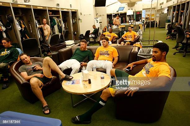 Jed Lowrie Sean Doolittle Josh Phegley and Marcus Semien of the Oakland Athletics relax in the clubhouse prior to the game against the Los Angeles...