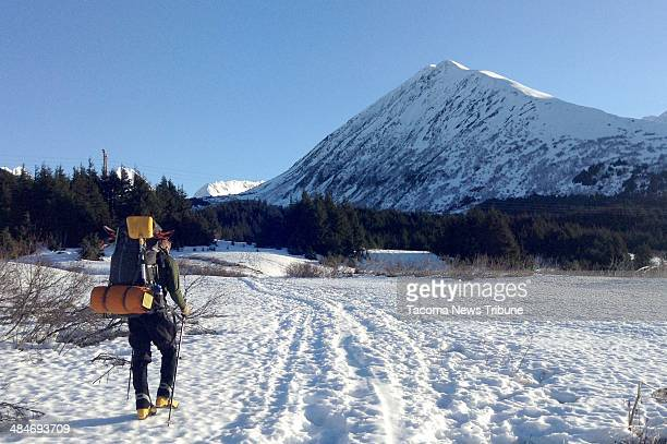 Jed Purcell sets out to the left of Sunburst Mountain also known as Kickstep Mountain for a winter camping trip in Turnagain Pass Although it was...