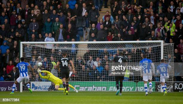 Jed Steer of Aston Villa saves a penalty during the Carabao Cup First Round match between Colchester United and Aston Villa at the Colchester...