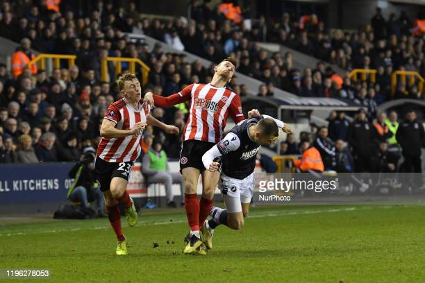 Jed Wallace of Millwall and Jack Robinson Michael Verrips of Sheffield United in action during the FA Cup Fourth Round match between Millwall and...