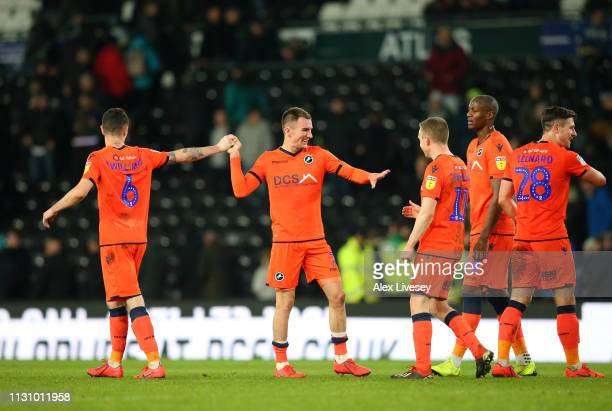 Jed Wallace of Millwall celebrates with team mates after the Sky Bet Championship match between Derby County and Millwall at Pride Park Stadium on...