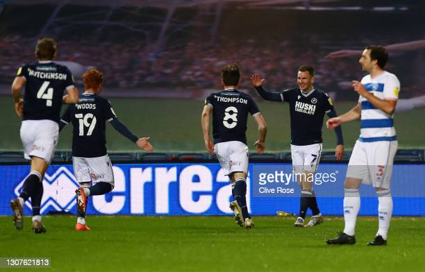 Jed Wallace of Millwall FC celebrates with teammates Ryan Woods and Ben Thompson after scoring their team's first goal during the Sky Bet...