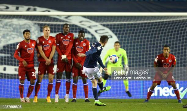 Jed Wallace of Millwall FC scores his teams first goal from a free kick during the Sky Bet Championship match between Millwall and Reading at The Den...