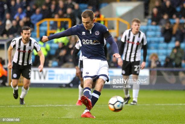 Jed Wallace of Millwall scores his side's first goal from a penalty during The Emirates FA Cup Fourth Round match between Millwall and Rochdale AFC...