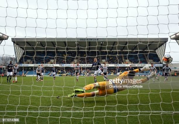 Jed Wallace of Millwall scores their 1st goal from the penalty spot during The Emirates FA Cup Fourth Round match between Millwall and Rochdale AFC...