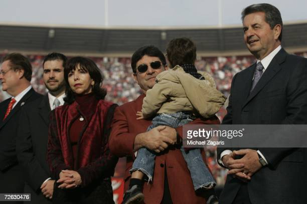 Jed York Denise DeBartolo York Edward J DeBartolo Jr and Carmen Policy look on during a ceremony in Jerry Rice's honor at half time of the game...