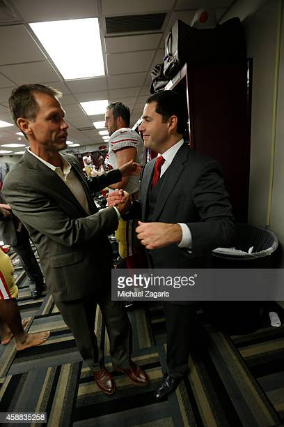 Jed York of the San Francisco 49ers celebrates with General Manager Trent Baalke in the locker room following the game against the New Orleans Saints...
