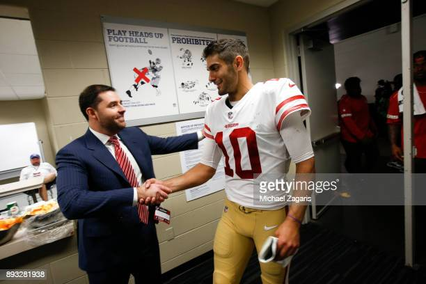 Jed York of the San Francisco 49ers congratulates Jimmy Garoppolo at the locker room following the game against the Houston Texans at NRG Stadium on...