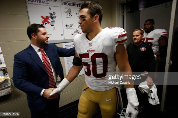 Jed York of the San Francisco 49ers greets Brock Coyle at the locker room following the game against the Houston Texans at NRG Stadium on December...