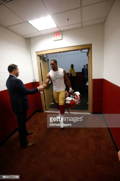 Jed York of the San Francisco 49ers greets Eric Reid at the locker room following the game against the Washington Redskins at FedEx Field on October...