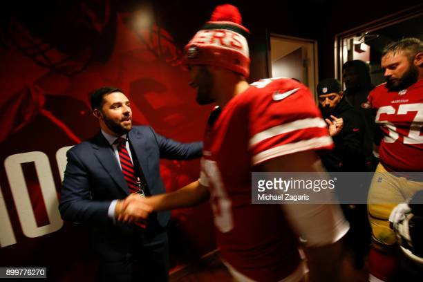 Jed York of the San Francisco 49ers greets Jimmy Garoppolo at the locker room following the game against the Jacksonville Jaguars at Levi's Stadium...