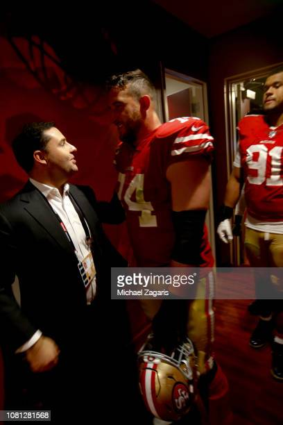 Jed York of the San Francisco 49ers greets Joe Staley in the locker room following the game against the Denver Broncos at Levi's Stadium on December...