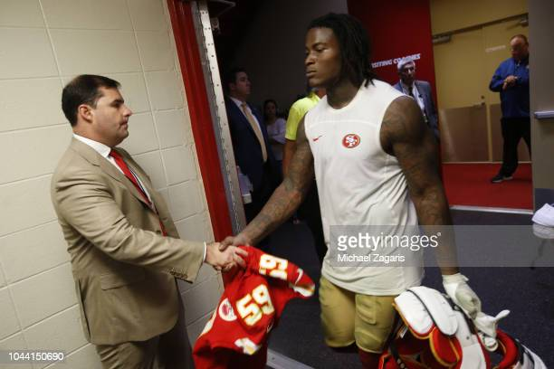 Jed York of the San Francisco 49ers greets Reuben Foster in the locker room following the game against the Kansas City Chiefs at Arrowhead Stadium on...