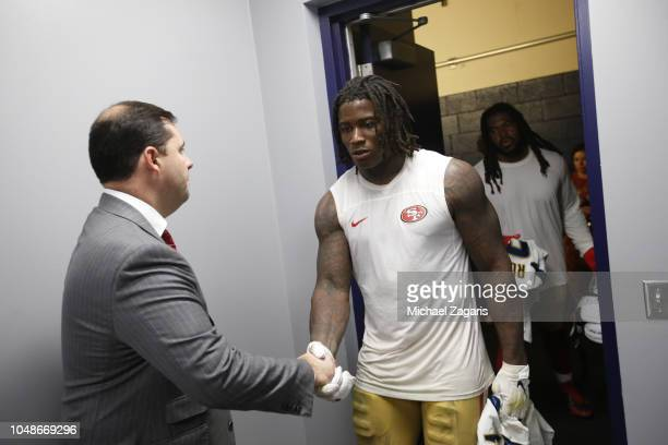 Jed York of the San Francisco 49ers greets Reuben Foster in the locker room following the game against the Los Angeles Chargers at StubHub Center on...
