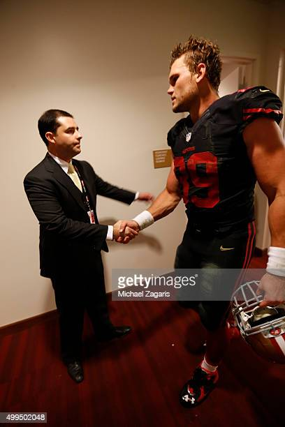 Jed York of the San Francisco 49ers greets Vance McDonald at the locker room following the game against the Arizona Cardinals at Levi Stadium on...