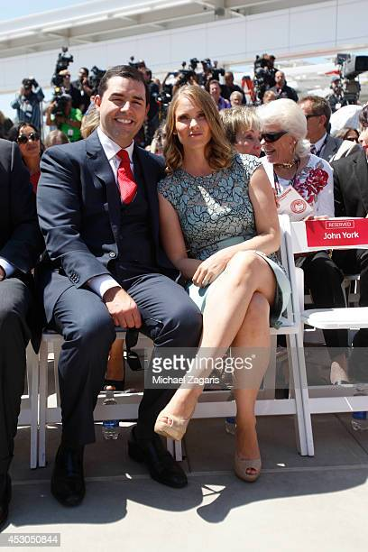 Jed York of the San Francisco 49ers sits with his wife Danielle York sit in the crowd during the the Ribbon Cutting Ceremony for Levi Stadium on July...
