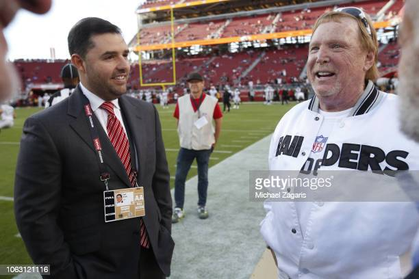 Jed York of the San Francisco 49ers talks with Owner Mark Davis of the Oakland Raiders on the sideline prior to the game at Levi's Stadium on...