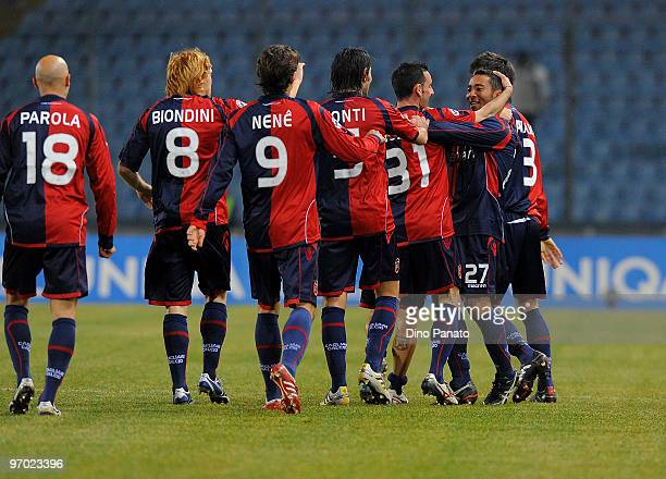 Jeda of Cagliari celebrates with Alessandro Agostini and teammates after scoring the opening goal of the Serie A match between Udinese Calcio and...