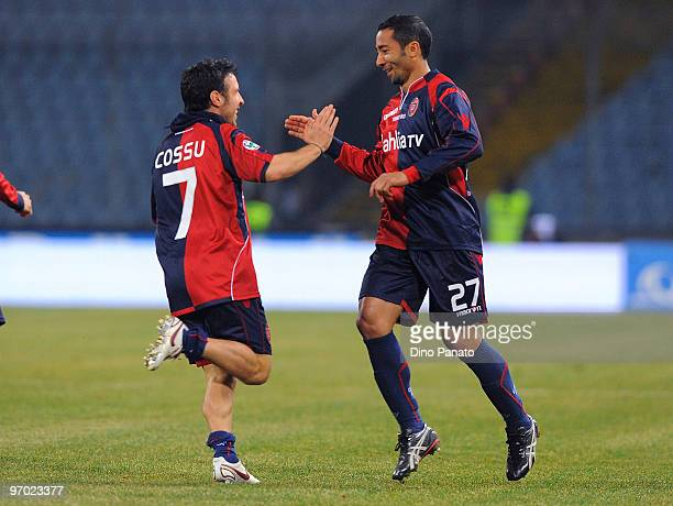 Jeda of Cagliari celebrates with teammate Andrea Cossu after scoring the 10 goal during the Serie A match between Udinese Calcio and Cagliari Calcio...
