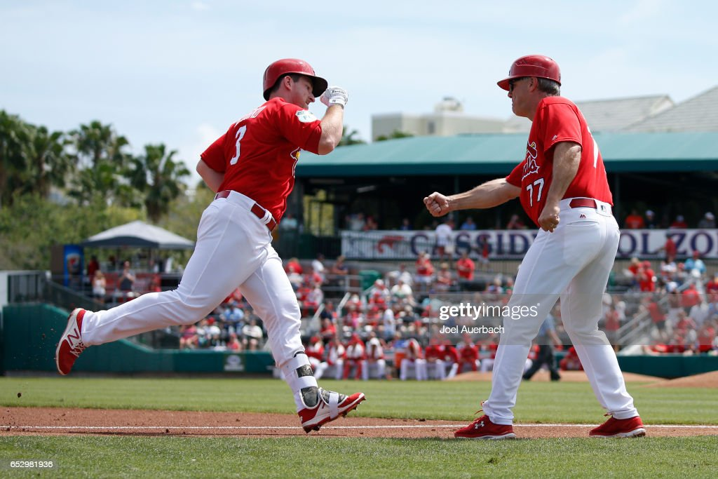 Jedd Gyorko #3 is congratulated by third base coach Chris Maloney #77 of the St Louis Cardinals after hitting a two run home run against the Houston Astros in the second inning during a spring training game at Roger Dean Stadium on March 13, 2017 in Jupiter, Florida. The Cardinals defeated the Astros 6-3.