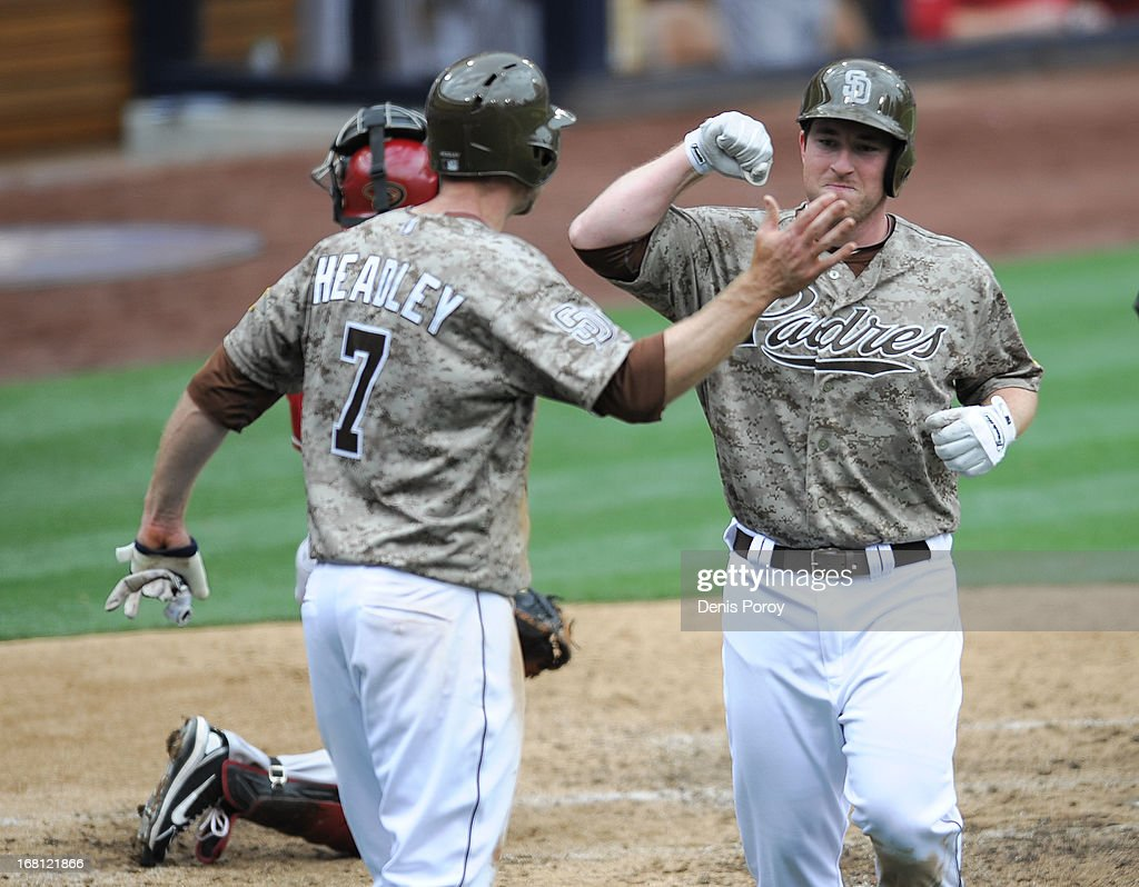 Jedd Gyorko #9 of the San Diego Padres is congratulated by Chase Headley #7 after he hit a two-run homer during the sixth inning of a baseball game against the Arizona Diamondbacks at Petco Park on May 5, 2013 in San Diego, California.