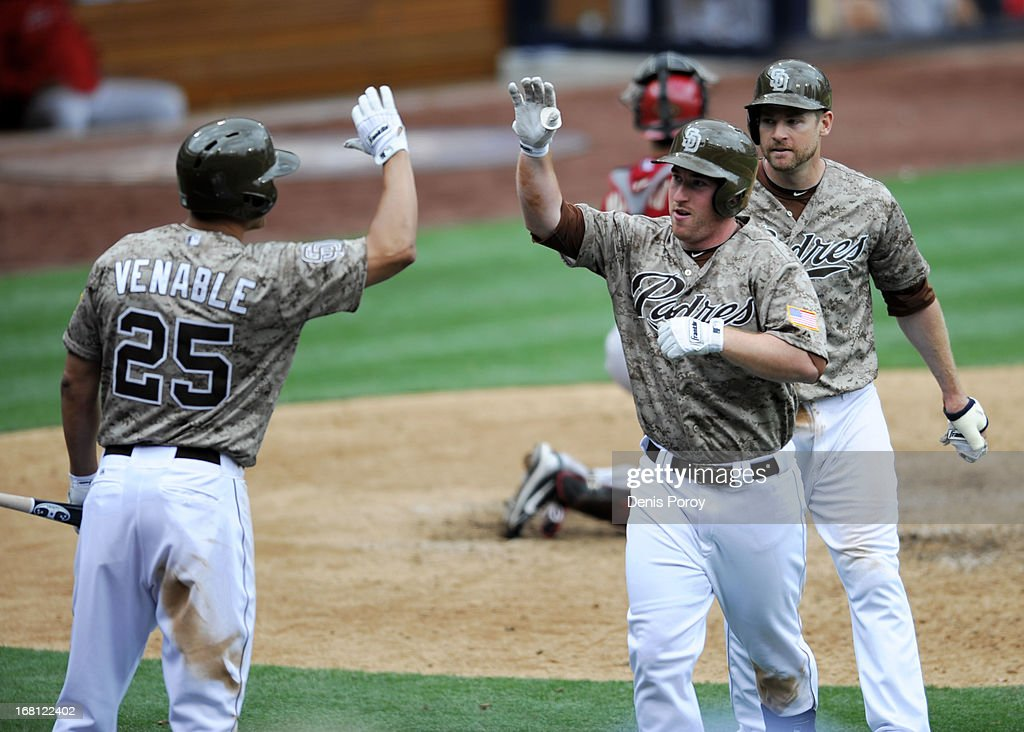 Jedd Gyorko #9 of the San Diego Padres (C) is congratulated by Will Venable #25 as Chase Headley #7 looks on after he hit a two-run homer during the sixth inning of a baseball game against the Arizona Diamondbacks at Petco Park on May 5, 2013 in San Diego, California. The Padres won 5-1.