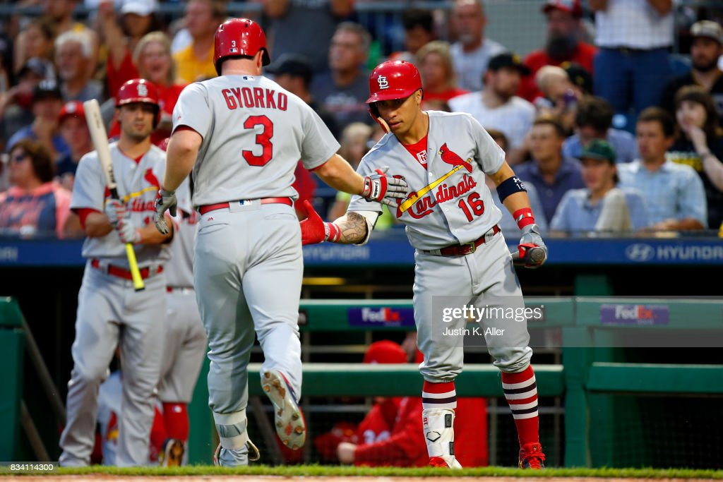 Jedd Gyorko #3 of the St. Louis Cardinals celebrates with Kolten Wong #16 after hitting a solo home run in the second inning against the Pittsburgh Pirates at PNC Park on August 17, 2017 in Pittsburgh, Pennsylvania.