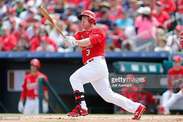 Jedd Gyorko of the St Louis Cardinals hits a double that scored a run against the Boston Red Sox during the third inning of a spring training game at...