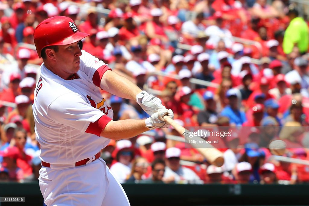 Jedd Gyorko #3 of the St. Louis Cardinals hits a sacrifice RBI against the New York Mets in the first inning at Busch Stadium on July 9, 2017 in St. Louis, Missouri.