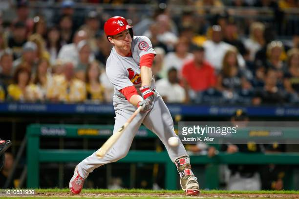 Jedd Gyorko of the St Louis Cardinals hits an RBI single in the fifth inning against the Pittsburgh Pirates at PNC Park on August 3 2018 in...