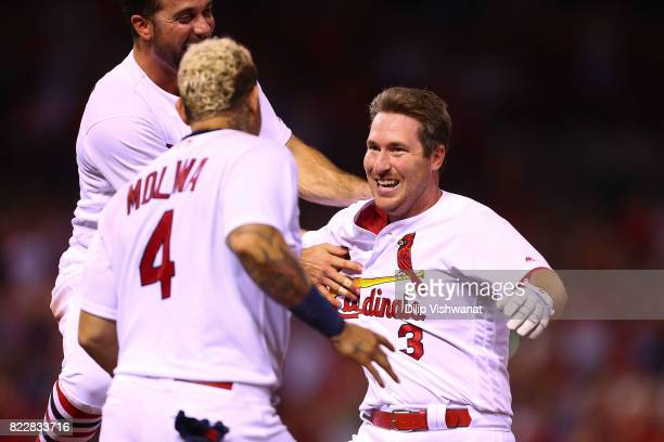 Jedd Gyorko of the St Louis Cardinals is mobbed by his teammates after batting in the gamewinning RBI against the Colorado Rockies in the ninth...